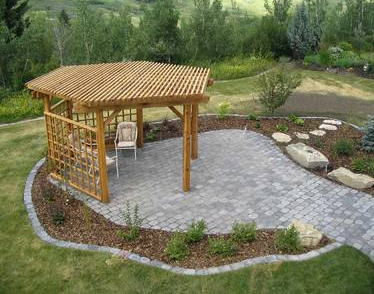 Hexagon Pergola On Stone Patio With Trellis Walls